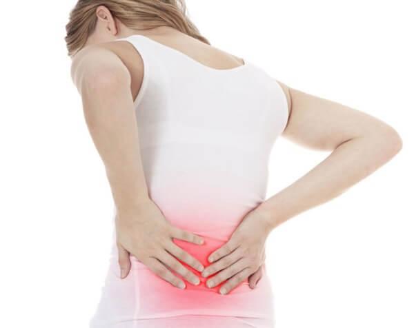 Đau lưng là 1 trong những triệu chứng mang thai